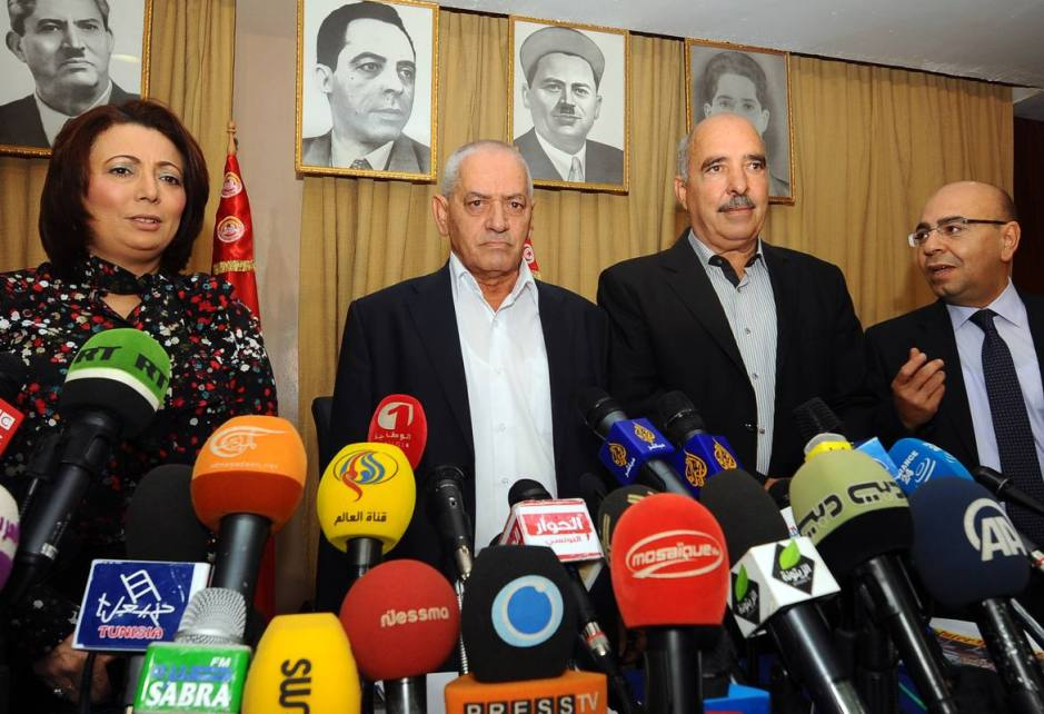 (FILES) A photo taken on September 21, 2013 shows Tunisian mediators (LtoR) the President of the Tunisian employers union (UTICA), Wided Bouchamaoui, Secretary General of the Tunisian General Labour Union (UGTT) Houcine Abbassi (L) , President of the Tunisian Human Rights League (LTDH), Abdessattar ben Moussa and the president of the National Bar Association, Mohamed Fadhel Mahmoud at a press conference in Tunis. Tunisian national dialogue mediators won the 2015 Nobel Peace Prize, the Norwegian Nobel Commitee announced on October 9, 2015.  AFP PHOTO / FETHI BELAID
